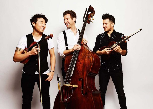 "Members of the group Time for Three; (l-r) Charles Yang , violin, Ranaan Meyer, double-bassist, and Nicolas ""Nick"" Kendall, violin."