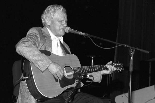 Doc Watson performing in 1994