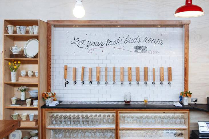"Pictured: ""Let your taste buds roam"" over bar taps."
