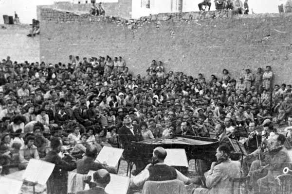 Bernstein playing Beethoven's 1st Piano Concerto with the Israel Philharmonic Orchestra.