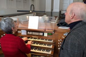 Organist Jane Cain works on the WDAV audio theme with Dan Locklair.
