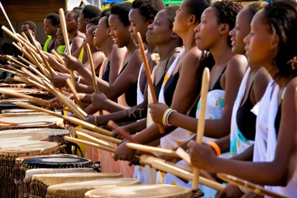 Women drumming.