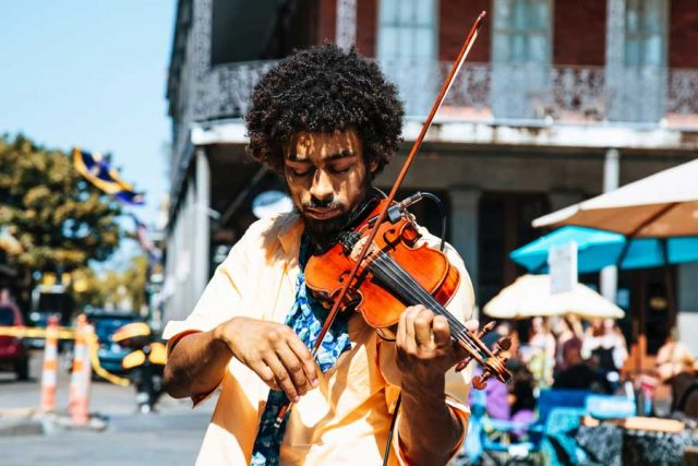 Musician playing violin; Photo by William Recinos on Unsplash
