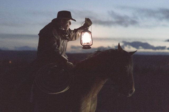 Man on horse with lantern. Photo by Priscilla Du Preez.