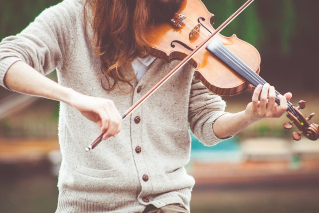 Person playing violin; photo by Photo by Clem Onojeghuo on Unsplash.