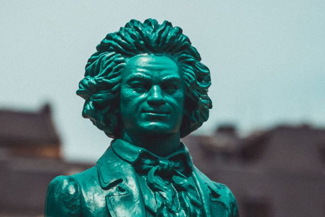 Statue of Beethoven with smirk. Photo by Maxim Abramov on Unsplash.