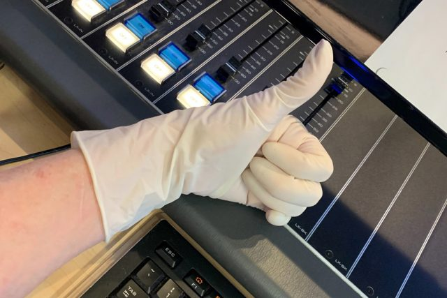 Thumbs up glove over keyboard. Courtesy of Myelita Melton.