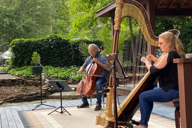 Cellist Alan Black and harpist Andrea Mumm.