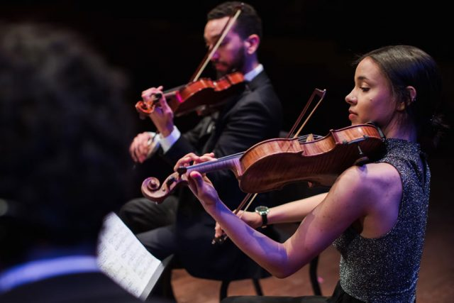 Members of the Ivalas Quartet play center stage at the 2019 Young Chamber Musician's Competition.