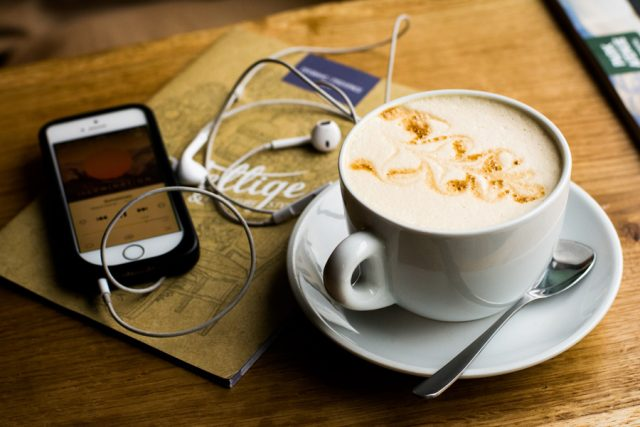 BB Coffee Shop - Phone with earphones with cup of coffee - Photo by Juja Han.