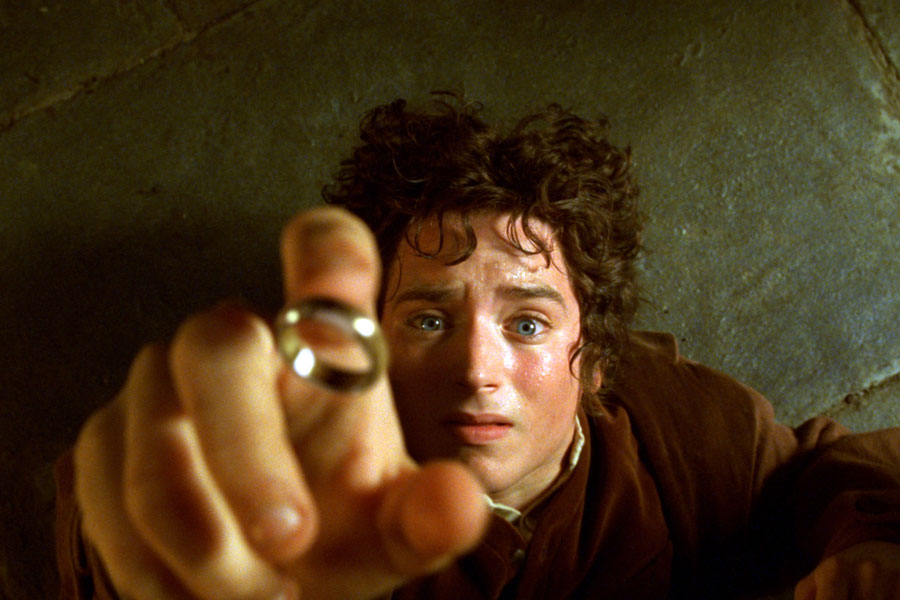Still from Lord of the Rings with Frodo (Elijah Wood) reaching for a ring.