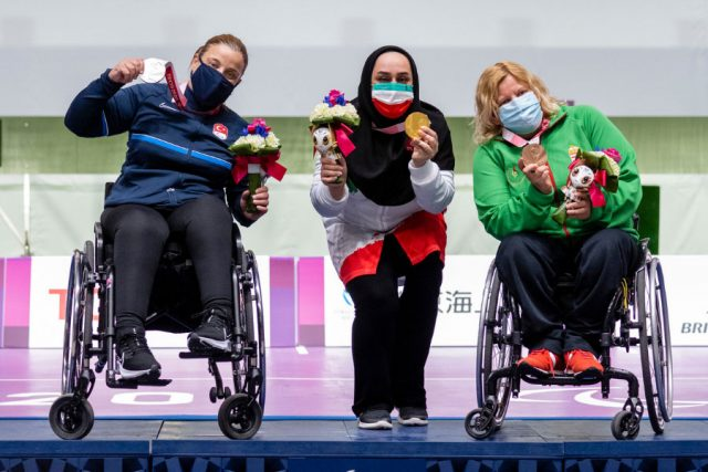 Sareh Javanmardi from Iran, gold medalist, Aysegul Pehlivanlar from Turkey, silver medalist, and Krisztina David from Hungary, bronze medalist in P2 - Women's 10m Air Pistol SH1 at the Asaka Shooting Range during the Paralympic Games on August 31.
